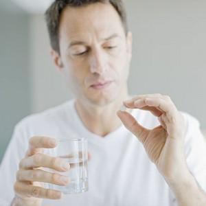 man-taking-pill-400x400
