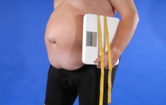 man-holding-scales-trying-to-lose-weight