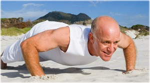 getty_rf_photo_of_senior_man_doing_pushups_on_beach